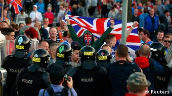 Loyalist protesters confront the police in the Woodvale Road area of North Belfast, July 14, 2013, on the third night of unrest after an Orange Parade was blocked from marching past the Nationalist Ardoyne area. (Photo: REUTERS/Cathal McNaughton)