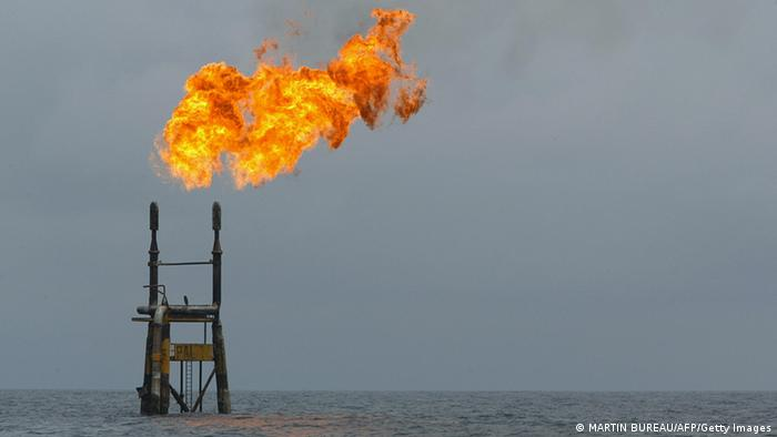 -, ANGOLA: A view of an oil flare from a Total Elf Fina oil well off the Angolan coast 16 October 2003. Economists said 18 March 2004 that the recent surge in the price of oil, which jumped to its highest level in 13 years 17 March in New York, threatens to depress eurozone consumption despite the strong euro. AFP PHOTO MARTIN BUREAU (Photo credit should read MARTIN BUREAU/AFP/Getty Images)