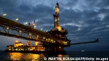 Luanda, ANGOLA: TO GO WITH AFP STORY IN FRENCH :Les prix du petrole se stabilisent apres le consensus atteint a l'Opep - (FILES) General view of an oil offshore platform owned by Total Fina Elf in the surroundings waters of the Angolan coast 15 October 2003. The 11 members of the OPEC oil cartel have agreed to slash output by a million barrels a day, the OPEC president said 11 October 2006, in a move aimed at shoring up sliding world crude prices. AFP PHOTO MARTIN BUREAU (Photo credit should read MARTIN BUREAU/AFP/Getty Images)