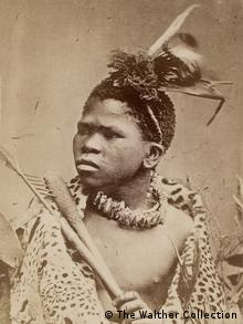 "A carte de visite by the British Gray Brothers captioned ""Zulu / Young Warrior in fighting order, and in skin Kaross. Armed with hatchet and assegai,"" South Africa. c. 1870"