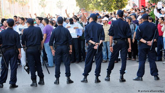 A line of police in front of a demonstration in Casablanca, May 2011