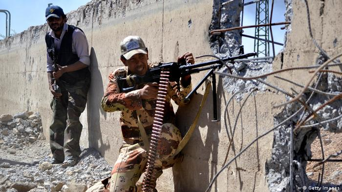 Syrian rebels clash with government forces (unseen) at a military airport in Syria's northeastern city of Deir Ezzor on July 1, 2013. Fighting between rebels and regime loyalists continue amid diplomatic efforts to end the two-year conflict that has killed more than 100,000 people since March 2011, according to the Syrian Observatory for Human Rights. AFP PHOTO/KARAM JAMAL (Photo credit should read KARAM JAMAL/AFP/Getty Images)