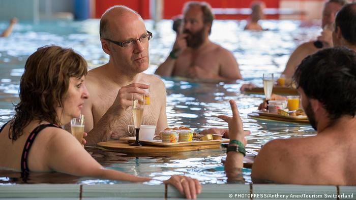 The Swiss Grand Tour participants have breakfast in one of the pools at the Thermal Baths in Leukerbad on Sunday 23 June 2013. 