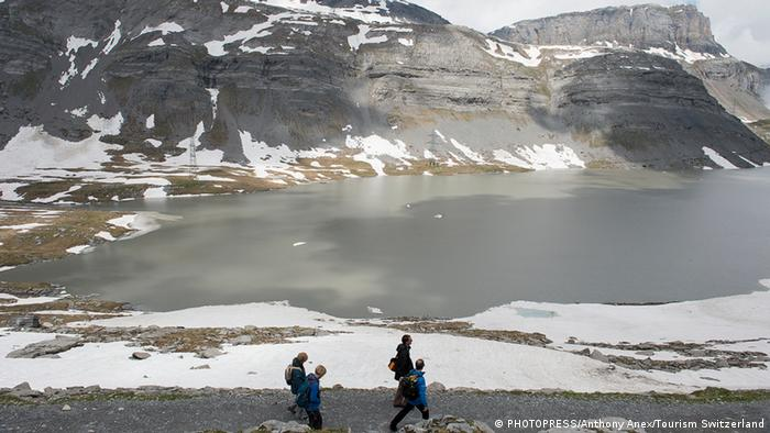 hikers at the Gemmi pass, Switzerland