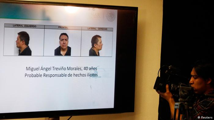 A cameraman films a screen showing photographs of Miguel Angel Trevino during a news conference in Mexico City July 15, 2013. The Mexican government said on Monday it had captured the leader of the Zetas drug cartel, delivering a boost to President Enrique Pena Nieto in his fight against violent crime. Miguel Angel Trevino, 40, known as Z-40, was captured early on Monday by Mexican Marines near the northern city of Nuevo Laredo on the U.S. border, a government spokesman told reporters. REUTERS/Bernardo Montoya (MEXICO - Tags: CRIME LAW CIVIL UNREST DRUGS SOCIETY)