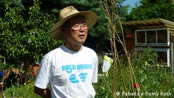 Lee Han-kyung in his garden in Germany