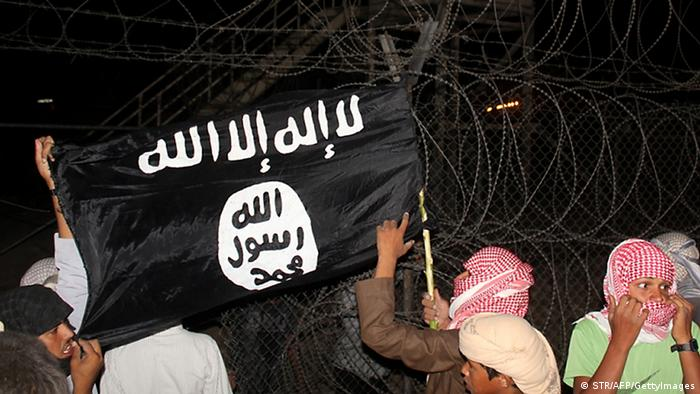 Bedouin protesters wave an Al-Qaeda-affiliated flag near a watch tower in Egypt's Sinai on September 14, 2012(Photo: STR/AFP/GettyImages)