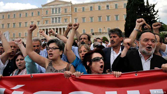 Anti-austerity protesters and parliamentarians of the anti-bailout radical leftist SYRIZA party participate in a rally in Athens, July, 16, 2013, during a 24-hour general strike. Trains ground to a halt and hospitals worked with emergency staff as Greek workers went on strike on Tuesday in protest at government plans to fire thousands of public sector employees. REUTERS/John Kolesidis (GREECE - Tags: POLITICS BUSINESS CIVIL UNREST)
