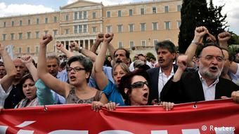 Anti-austerity protesters and parliamentarians of the anti-bailout radical leftist SYRIZA party participate in a rally in Athens, July, 16, 2013. REUTERS/John Kolesidis
