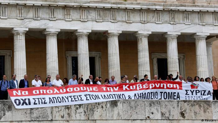 Parliamentarians of the anti-bailout radical leftist SYRIZA party hold a banner in front of the parliament in Athens, July, 16, 2013, during a 24-hour general strike in Greece. The banner reads Let's fire the government. No lay-offs in the state and private sector. REUTERS/Yannis Behrakis (GREECE - Tags: POLITICS BUSINESS CIVIL UNREST)
