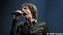 GLASTONBURY, ENGLAND - JUNE 29: Mick Jagger of The Rolling Stones performs on the Pyramid Stage at the Glastonbury Festival of Contemporary Performing Arts site at Worthy Farm, Pilton on June 29, 2013 near Glastonbury, England. The wholesale market caters for traders throughout the Festival who are estimated to provide 3 million meals for festival goers, crew and performers. Gates opened on Wednesday at the Somerset diary farm that will be playing host to one of the largest music festivals in the world and this year features headline acts Artic Monkeys, Mumford and Sons and the Rolling Stones. Tickets to the event which is now in its 43rd year sold out in minutes and that was before any of the headline acts had been confirmed. The festival, which started in 1970 when several hundred hippies paid 1 GBP to watch Marc Bolan, now attracts more than 175,000 people over five days. (Photo by Matt Cardy/Getty Images)