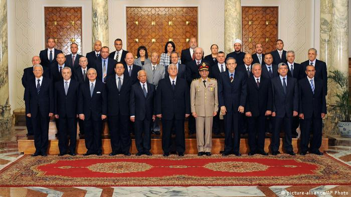 This image shows interim President Adli Mansour, center, with his new cabinet ministers at the presidential palace in Cairo, Egypt. Egypt's interim president has sworn in a new Cabinet, the first since the ouster of the Islamist president by the military nearly two weeks ago. (AP Photo/Egyptian Presidency)