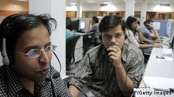 Indian employees of the Quark call center work during their night shift (Photo: STR/AFP/Getty Images)