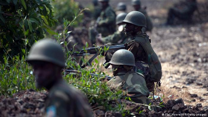 Congolese Army soldiers man a foward position in Kanyarucinya, some 12 kms from Goma, in the east of the Democratic Republic of the Congo. PHIL MOORE/AFP/Getty Images
