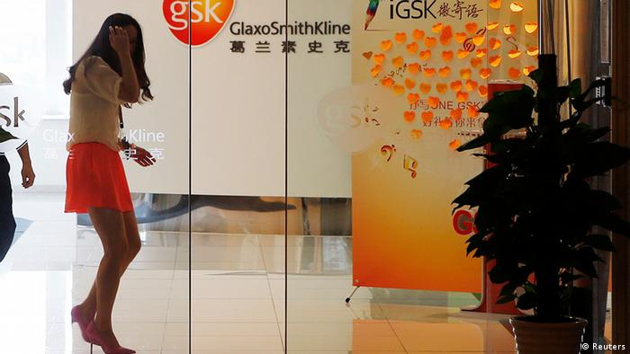 An employee walks inside a GlaxoSmithKline (GSK) office in Shanghai July 16, 2013. China must crack down on commercial bribery by multinational firms, the country's top state paper said on Wednesday, two days after police accused British drugmaker GlaxoSmithKline of the widespread bribery of Chinese officials and doctors. Picture taken July 16, 2013. REUTERS/Stringer (CHINA - Tags: BUSINESS HEALTH CRIME LAW) CHINA OUT. NO COMMERCIAL OR EDITORIAL SALES IN CHINA