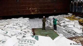 Worker stand on top of bags labeled Cuban Raw Sugar inside a North Korean flagged ship Chong Chon Gang docked at the Manzanillo Container Terminal in Colon City July 16, 2013. (Photo: Reuters)