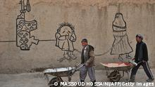 Afghan labourers walk in front of a mural in the old city of Kabul on March 28, 2011. From the dusty battlefields of Afghanistan to the skies over Libya, NATO is now engaged in two conflicts with no endgame in sight, posing a test for a war-weary alliance divided over the latest campaign. AFP PHOTO/Massoud HOSSAINI (Photo credit should read MASSOUD HOSSAINI/AFP/Getty Images) Erstellt am: 28 Mrz 2011