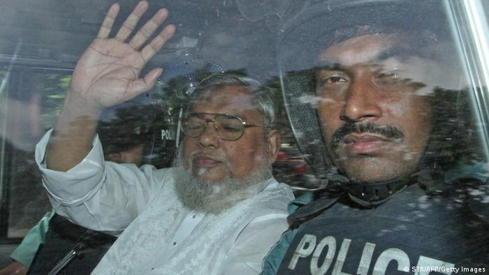 Mujahid in a police vechile as he is transported to the central jail following his court verdict in Dhaka (Photo via Getty Images)