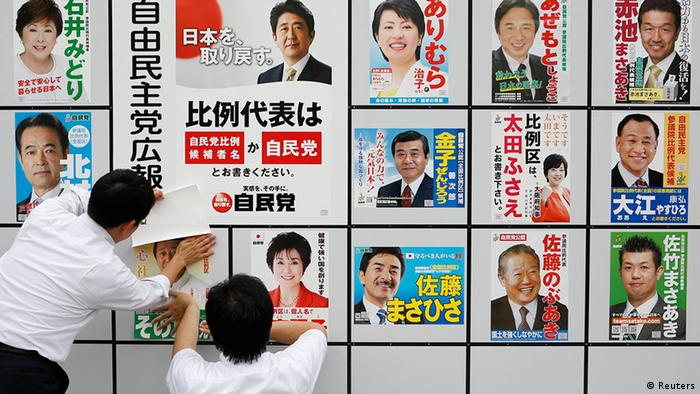Staff members of Japan's ruling Liberal Democratic Party (LDP) post posters of election candidates at the LDP headquarters in Tokyo July 4, 2013, the start day of campaigning for the July 21 upper house election. (Photo: Reuters))