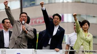 Japan's Prime Minister Shinzo Abe (C), who is also leader of the ruling Liberal Democratic Party, raises his fist with his party members at the start day of campaigning for the July 21 Upper house election in Tokyo July 4, 2013. (Photo: Reuters)