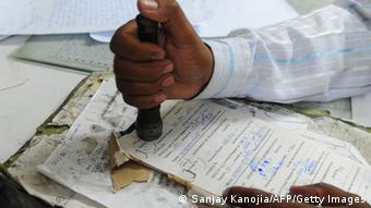 In this picture taken on July 12, 2013, an Indian employee stamps a telegraph message at Katchehri telegraph office, in Allahabad. (Photo: AFP)