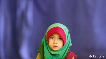 Young Malaysian Muslim, Aisyah Fatoni, 6, reads a prayer as she waits for her father performing Asr prayer during the month of Ramadan at a mosque in Kuala Lumpur July 15, 2013. (Photo: REUTERS/Bazuki Muhammad)