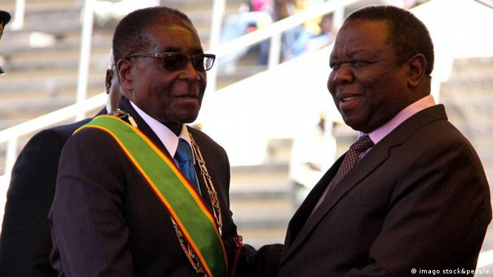 Robert Mugabe(L) greets Morgan Tsvangirai (R) upon his arrival at the 31st Independence celebration in Harare