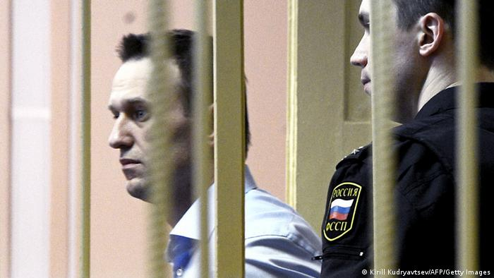 Russian protest leader Alexei Navalny walks past a guard as he attends a hearing of his case in a court in the provincial northern city of Kirov on April 24, 2013. Navalny went today on trial on charges that he says were ordered by President Vladimir Putin in revenge for him daring to oppose the Kremlin. AFP PHOTO/KIRILL KUDRYAVTSEV (Photo credit should read KIRILL KUDRYAVTSEV/AFP/Getty Images)