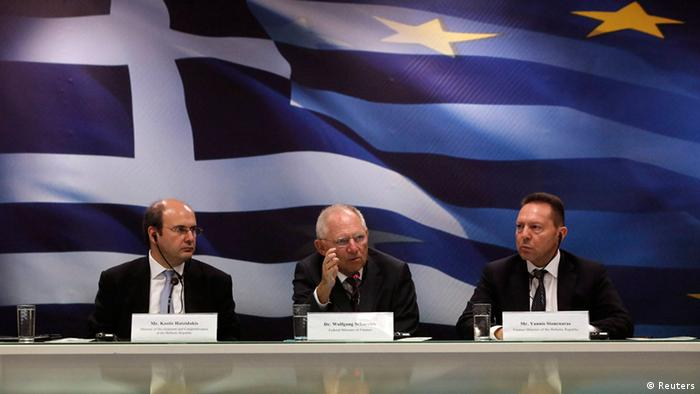 German Finance Minister Wolfgang Schaeuble flanked by his Greek counterpart Yannis Stournaras (R) and Greece's Minister for Development & Competitiveness Kostis Hatzidakis Photo: REUTERS/John Kolesidis