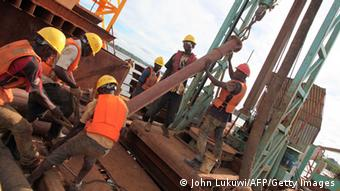 Workers at a Chinese bridge-building site in Tanzania
