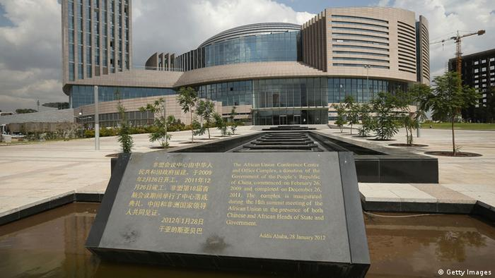 A picture of the AU headquarters with a plaque in the foreground (Getty Images)