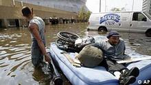 Leeland Martin, left, pulls his brother, Milton, to the Louisiana Superdome on a inflatable mattress Tuesday, Aug. 30, 2005, in New Orleans. (AP Photo/The Lafayette Daily, John Rowland)
