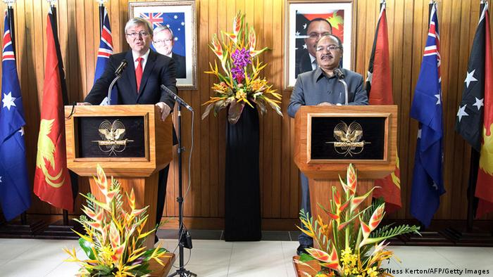 Australian Prime Minister Kevin Rudd (L) speaks alongside Papua New Guinea's Prime Minister Peter O'Neill during a joint press conference in Port Moresby on July 15, 2013. Australia on July 15 said it will send 50 police to Papua New Guinea to help tackle chronic law and order problems, a day after armed soldiers attacked people indiscriminately at a hospital. AFP PHOTO / NESS KERTON (Photo credit should read Ness Kerton/AFP/Getty Images)