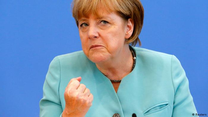 German Chancellor Angela Merkel gestures as she address media during a news conference at Bundespressekonferenz in Berlin July 19, 2013. REUTERS/Tobias Schwarz (GERMANY - Tags: POLITICS)