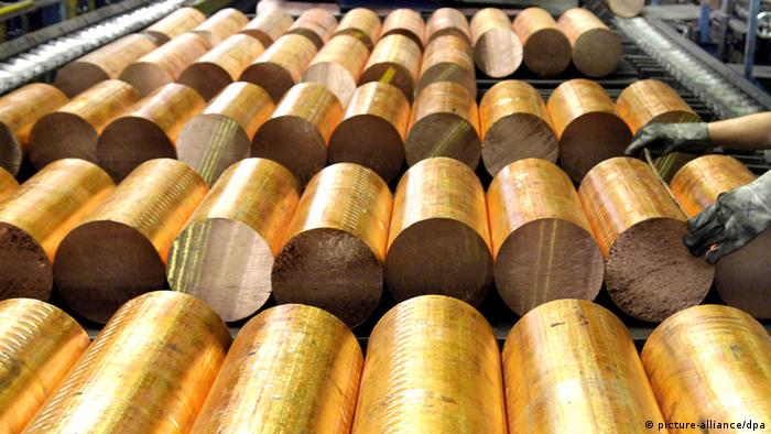 Rolls of golden copper in a factory.