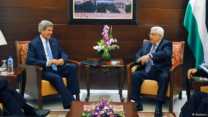U.S. Secretary of State John Kerry (L) meets with Palestinian President Mahmoud Abbas at the Mukataa compound, in the West Bank city of Ramallah July 19, 2013. REUTERS/Mandel Ngan/Pool (WEST BANK (POLITICS)
