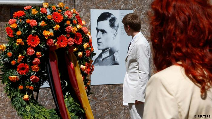 Visitors walk past a portrait of Claus Schenk Graf von Stauffenberg, who conspired to overthrow Adolf Hitler, in the Bendlerblock building during a ceremony in Berlin(Photo: REUTERS/ Tobias Schwarz)