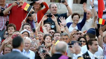 Fans celebrate the new Belgian King Philippe in 2013