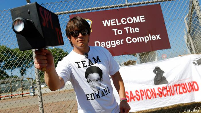 Daniel Bangert, initiator of the protest, holds a mock TV camera outside the Dagger Complex, which is used by the US Army intelligence services, during a demonstration against the National Security Agency and in support of whistle-blower Edward Snowden in Griesheim, July 20 (Photo: REUTERS/ Kai Pfaffenbach)