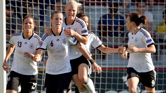 Simone Laudehr (2nd l) celebrates her goal with Celia Okoyino da Mbabi, Leonie Maier and Nadine Keßler (r) of Germany during the UEFA Women's EURO 2013 quarter final soccer match between Germany and Italy at the Växjö Arena in Vaxjo, Sweden, 21 July 2013. (Photo via Carmen Jaspersen/dpa)