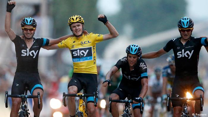 Team Sky rider and leader's yellow jersey holder Christopher Froome of Britain, winner of the centenary Tour de France cycling race, celebrates his overall victory with team mates after the 133.5km final stage, from Versailles to Paris Champs Elysees, July 21, 2013. REUTERS/Eric Gaillard (FRANCE - Tags: SPORT CYCLING TPX IMAGES OF THE DAY)