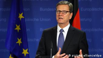 epa03797202 German Foreign Minister Guido Westerwelle speaks to members of the media during a foreign affairs council meeting at the EU Council headquarters in Brussels, Belgium, 22 July 2013. European Union foreign ministers were set to tackle the thorny question of whether Hezbollah's military wing should be blacklisted as a terrorist organization, as well as talks on Egypt and Syria. EPA/JULIEN WARNAND pixel