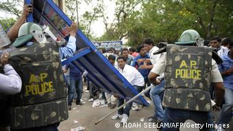 Indian students of the Telangana Joint Action Committee (T-JAC) overturn barricades as police prevent the students from marching to the 'Assembly' during a pro-Telangana protest in Hyderabad on June 13, 2013. (Photo: NOAH SEELAM/AFP/Getty Images)