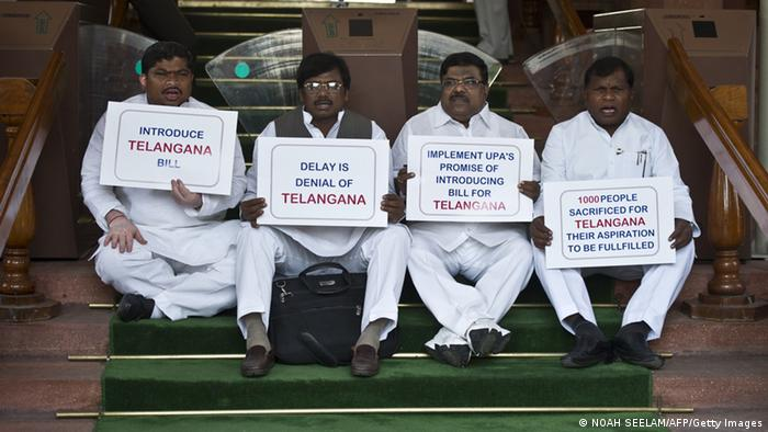 Congress Party Members of Parliament from Telangana - a region of the central state of Andhra Pradesh - sit in protest to demand the introduction of the Telangana Bill at Parliament in New Delhi on April 23, 2013. Parliament is likely to witness major disruptions, with the opposition preparing to take on the Manmohan Singh government on Coalgate and the draft JPC report on the 2G spectrum scam, as the House opens for the second half of the budget session. New Delhi agreed in 2009 to the partition of Andhra Pradesh, India's fifth-largest state in terms of territory, but soon after it said the proposal needed more consultation following a fierce political backlash. AFP PHOTO/Prakash SINGH (Photo credit should read PRAKASH SINGH/AFP/Getty Images)