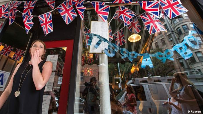 Employee Hayley Simmonds reacts as she celebrates the news that Britain's Catherine, Duchess of Cambridge, has given birth to a son, outside the British themed restaurant Tea & Sympathy in New York, July 22, 2013. (Photo: REUTERS/Lucas Jackson )