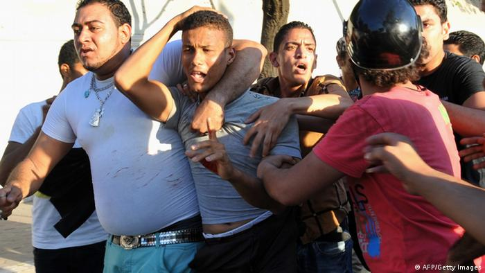 Pro-government and army supporters detain a supporter of deposed Egyptian President Mohamed Mursi during clashes that erupted in Tahrir Square and around the US Embassy in Cairo, on July 22, 2013. Dozens of people were injured in Cairo clashes as the family of Mohamed Morsi said they plan to sue Egypt's army chief for having 'kidnapped' the ousted Islamist president. AFP PHOTO/FAYEZ NURELDINE (Photo credit should read FAYEZ NURELDINE/AFP/Getty Images)