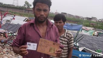 Myanmar's Rohingya refugee Mohammad Jakariya with his Burmese Id and new ID of UNHCR in a refugee camp in DElhi
