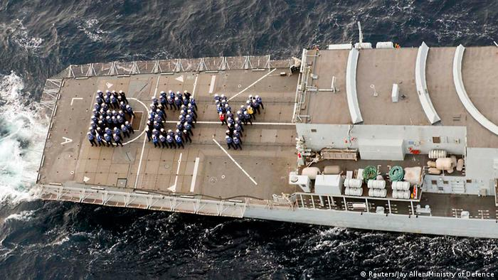 The ship's company of the Royal Navy frigate HMS Lancaster forms the word BOY on the aft deck to mark the birth of Britain's new prince while on patrol in the Caribbean in a photo released by Britain's Ministry of Defence and released to Reuters on July 23, 2013. The world was awaiting the first glimpse of Britain's new prince on Tuesday with camera crews poised to photograph Prince William and his wife, Kate, leaving a London hospital with their baby son. Catherine, Duchess of Cambridge gave birth to the couple's first child, who is third in line to the British throne, on Monday afternoon, ending weeks of feverish anticipation about the arrival and surprising royal watchers, who were widely expecting a girl. REUTERS/Jay Allen/Ministry of Defence/Handout via Reuters (CARIBBEAN - Tags: ROYALS ENTERTAINMENT MILITARY HEALTH) ATTENTION EDITORS - THIS IMAGE WAS PROVIDED BY A THIRD PARTY. FOR EDITORIAL USE ONLY. NOT FOR SALE FOR MARKETING OR ADVERTISING CAMPAIGNS. NO COMMERCIAL OR BOOK SALES. NO SALES. NO ARCHIVES. FOR EDITORIAL USE ONLY. THIS IMAGE HAS BEEN SUPPLIED BY A THIRD PARTY. IT IS DISTRIBUTED, EXACTLY AS RECEIVED BY REUTERS, AS A SERVICE TO CLIENTS