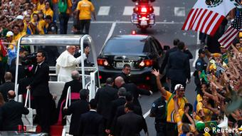 Pope Francis waves to faithful as he arrives in Rio de Janeiro July 22, 2013. Welcomed by a committee of local dignitaries, including President Dilma Rousseff, Francis waved to onlookers before proceeding to a motorcade through Rio's city center, where local Catholics, visiting pilgrims and the curious were gathered to receive him. The new pope was then scheduled to meet Rousseff and other officials at a government palace nearby. REUTERS/Stefano Rellandini (BRAZIL - Tags: RELIGION POLITICS TPX IMAGES OF THE DAY)