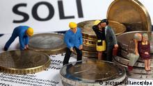 Symbolbild Modell Figuren Soli Solidaritätszuschlag BFH Bundesfinanzhof Euro Deutschland